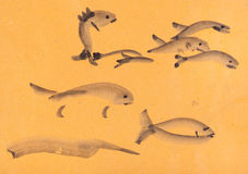 Sketches of fishes. Training drawing in suibokuga style with watercolor paints - sketches of fishes on orange colored paper Stock Photos