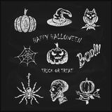 Sketches Halloween icons on black chalkboard. Halloween background, set of scary sketches icons drawn in white chalk on a black chalkboard, holiday theme Royalty Free Stock Photography