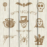 Sketches Halloween icons on white wooden background Royalty Free Stock Images