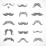 Sketches of moustaches on white Stock Images