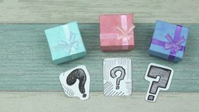 Color gift boxes and questions. Sketches of question marks on paper and gift boxes stock video footage
