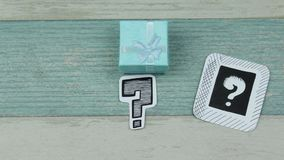 Turquoise gift box questions. Sketches of question marks on paper and gift boxes stock footage
