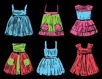 Sketches of the summer dresses for a little girl. Vector drawing of the various children dresses royalty free illustration