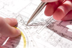 Sketching blueprint. Close up of a person sketching blueprint from angle Stock Photo