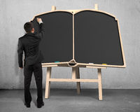 Sketching on book shape blackboard on easel Stock Photos