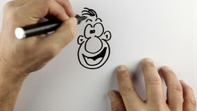 Sketching a cartoon doodle - time lapse stock footage