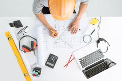 Sketching a construction project Royalty Free Stock Photos