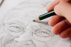 Sketching an Elderly Lady Royalty Free Stock Image