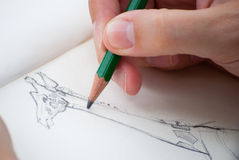 Sketching I. Artists hand capturing a giraffe Stock Photography