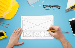 Sketching new website design. Modern flat design on paper.  stock photos
