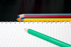 Sketchpad and colored pencils Royalty Free Stock Photo