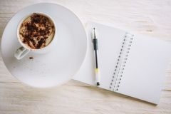 Sketchpad and cup of hot cocoa. Copyspace Stock Photography