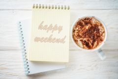 Sketchpad and a cup of hot cocoa. Sketchpad and cup of hot cocoa. Inscription in a notebook: Happy weekend Stock Images