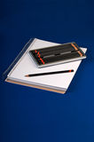 Sketchpad and drawing pencils. Sketchpad with assorted hardness of drawing pencils Stock Photos