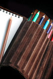 Sketchpad and pencils. A set for sketching consisting of sketchpad and colorful pencils Royalty Free Stock Image