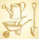 Sketchwatering can, shovel and barrow, vector  background Royalty Free Stock Photo