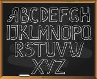 Sketchy alphabet on blackboard background. Royalty Free Stock Photos