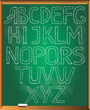 Sketchy alphabet on chalkboard background. Royalty Free Stock Photography