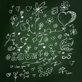Sketchy love heart design on blackboard Royalty Free Stock Photography