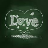 Sketchy love heart design on blackboard Royalty Free Stock Image