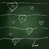Sketchy love heart design on blackboard Royalty Free Stock Photo