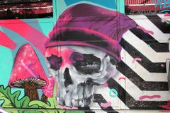 February 2019, Skeleton face street art walls, Florentin quarter, Tel Aviv. Sketeton face with a hat, white black stripes and mushrooms at a mural wall painting royalty free stock photos
