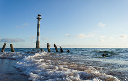 Skew lighthouse in the Baltic Sea. Royalty Free Stock Photos