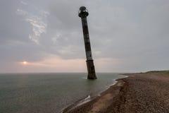 Skew lighthouse in the Baltic Sea. Stormy night on the beach. Kiipsaar, Harilaid, Saaremaa, Estonia, Europe. Skew lighthouse in the Baltic Sea. Stormy night on royalty free stock photos