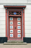 Skewed door in Kerteminde. Old skewed door in the village of Kerteminde, Denmark Stock Photos