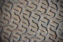 Skewed metal pattern background. Skewed linear metal pattern on the surface of the manhole lid - background image stock images