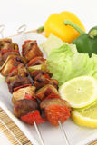 Skewer. Grilled meat and vegetable skewer royalty free stock image