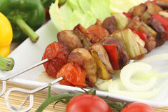 Skewer. Grilled meat and vegetable skewer royalty free stock images