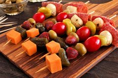 Skewer appetizers close up on wooden paddle board Royalty Free Stock Image