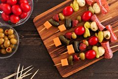 Skewer appetizers overhead table scene on wood Royalty Free Stock Images