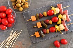 Skewer appetizers overhead scene on a slate server Stock Photography