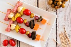 Skewer appetizers overhead scene on white wood Stock Images