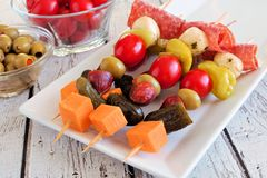Skewer appetizers close up table scene on white wood Royalty Free Stock Photography