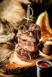 Skewer of BBQ Boar Filets Served on Wood Plank Stock Photos