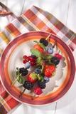 Skewer of berries in pot Royalty Free Stock Image