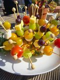 Skewer of cheese and fruits in a pineapple Stock Images