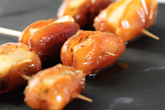Skewer dates and cheese on slate plate Stock Image