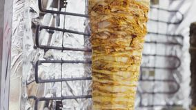 Skewer for doner kebab shawarma. fast food fat draining stock video