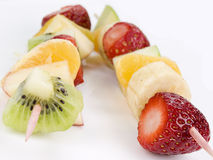 Skewer of fruits. Skewer fruit season isolated foreground royalty free stock image