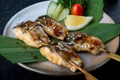 Skewer grilled saba fish with teriyaki sauce. Skewer grilled saba fish with teriyaki sauce set and serve in Japanese style royalty free stock image