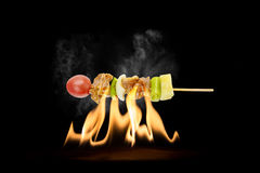 Skewer of mixed meat and vegetables on the grill Royalty Free Stock Photos