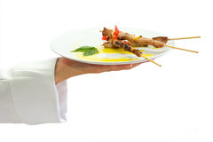 Skewer presentation from chef. On white background Stock Photo