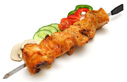 Skewer with shish-kebab and vegetables Stock Images