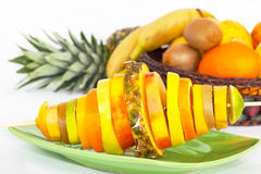 Skewer with slices of tropical fruit Stock Photos
