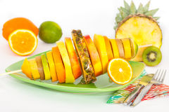 Skewer with slices of tropical fruit Stock Images