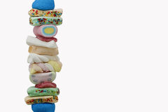 Skewer of sweet candies Royalty Free Stock Photography